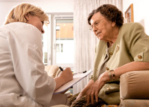caregiver talking to the old woman