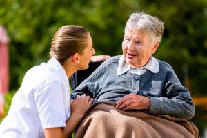 caregiver smiling to the senior woman